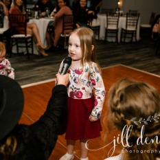 DJ Mandy holding the mic for flower girl to sing Let it Go